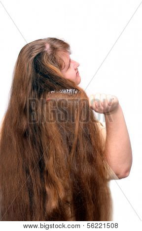 russian women combing her beautiful long red hair