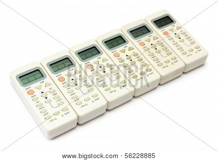 remote infrared devices in row isolated on white