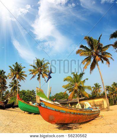 old fishing boats on beach - kerala india