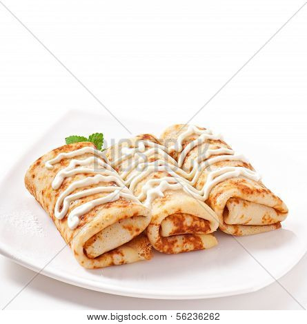 Pancakes stuffed with cottage cheese and sour cream