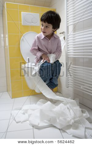 Nauthy little boy making a mess with toiletpaper