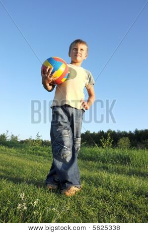Boy Holding Football Looking To Camera Faraway