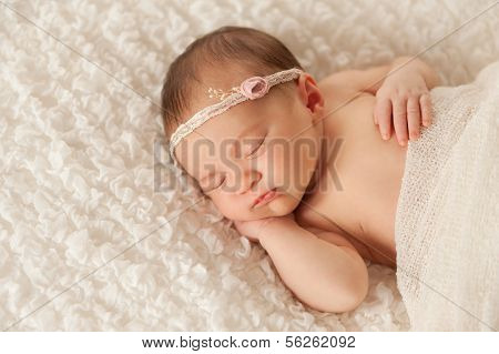 Portrait Of A Newborn Girl With Lace Headband