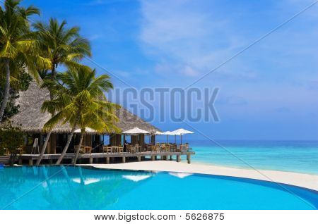Cafe And Pool On A Tropical Beach