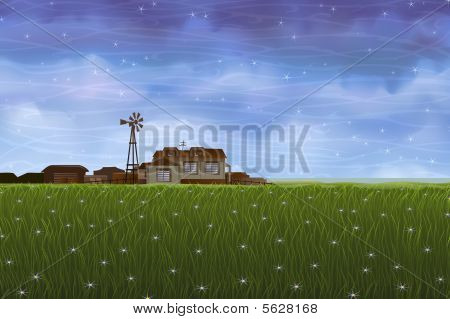 Small farm over green meadow
