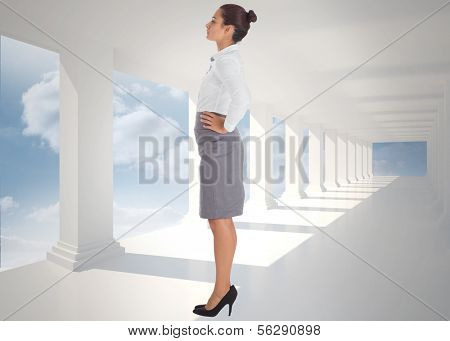 Focused businesswoman against bright white hall with columns