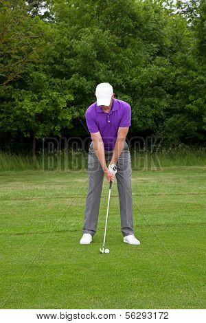 Male golfer playing a mid iron shot from the edge of the fairway, series of four images from addressing the ball to the follow through.