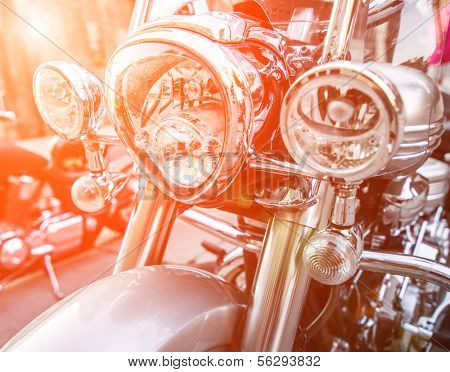 brilliant headlight motorcycle in sunlight