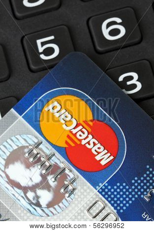 Ratingen, Germany - June 21, 2011: Closeup of MasterCard credit card on key pad. Mastercard is one of the biggest credit card companies in the world.