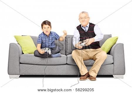 Senior man sitting on a couch and playing video games with his nephew, isolated on white background