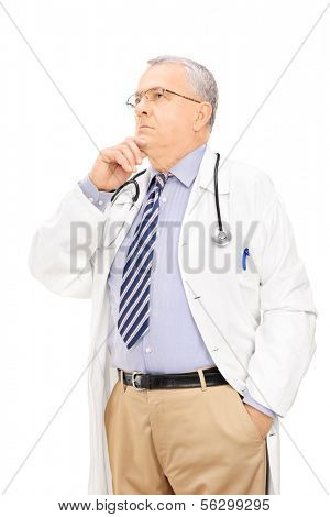 Middle aged male doctor deep in thoughts, isolated on white background