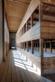 image of bunk-bed  - A representation of a row of bunk beds at a concentration camp memorial site - JPG