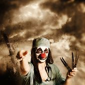 Scary Clown Doctor Throwing Knives Outdoors