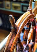 stock photo of ship steering wheel  - steering wheel sailboat on an old ship - JPG
