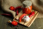 image of sackcloth  - Composition with salsa sauce in glass jar - JPG