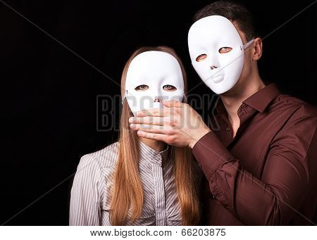 Fashion Happy Couple In Love Holding With Mask Face. Psychological Concept. Duality Look At Relation