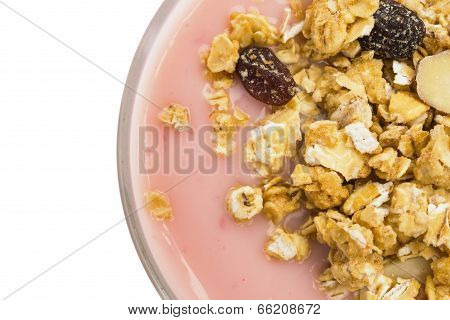 Top View Wholegrain Muesli On Top Of Strawberry Flavor Yogurt With Clipping Path