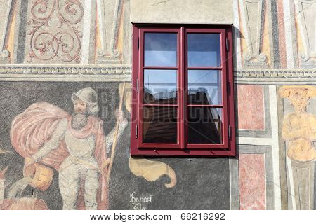 Red Window Of The Painted Building