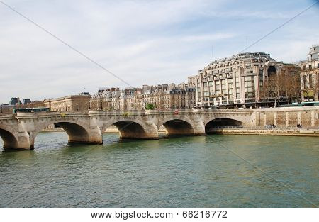 PARIS, FRANCE - MARCH 19, 2014: The historic Pont Neuf bridge crossing the River Seine. The oldest of the 35 bridges in Paris, construction was started in 1578.