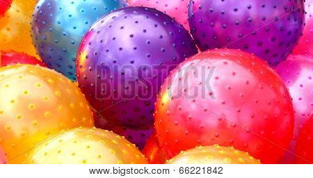 Colorful red purple yellow blue rubber balls