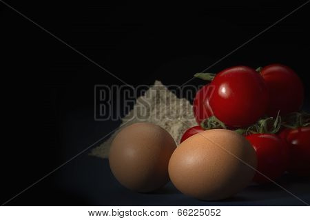 Fresh Brown Eggs, Cherry Tomatoes And Flour