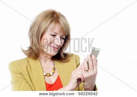 Attractive Businesswoman Using A Smartphone