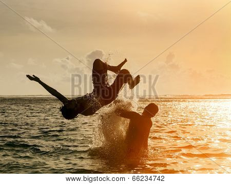 Silhouette Of Young Man Jumping Out Of Ocean