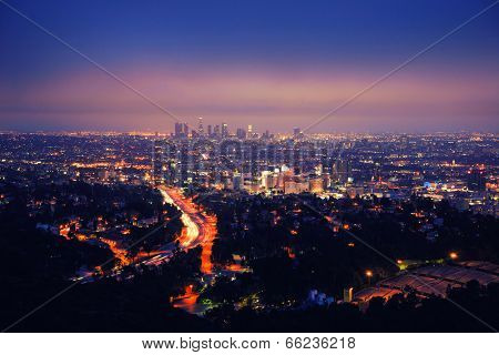 Los Angeles skyline at night, view from Hollywood Hills towards 101 freeway and downtown.