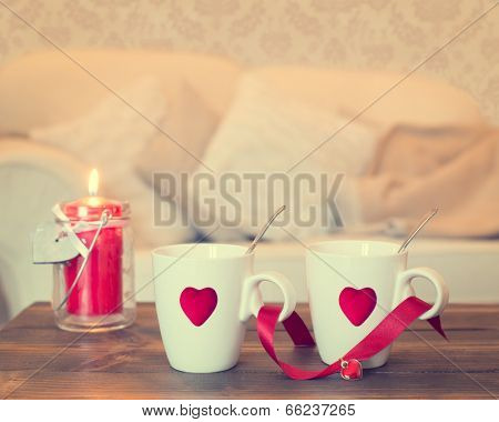 Two teacups with heart decoration - vintage effect added