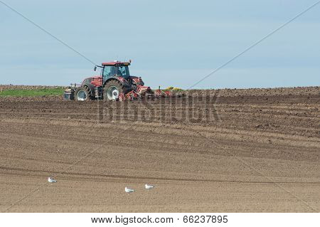 Tractor Plowing Agricultural Land