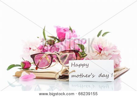 Bouquet Of Peonies  On Old Book With Glasses