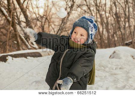 Playing Throwing Snowballs.