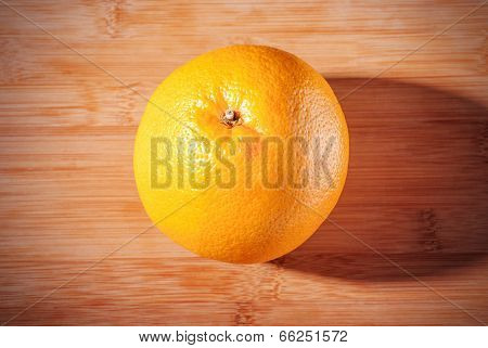 Grapefruit On Wooden Board