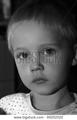 Black And White Portrait Of Boy.