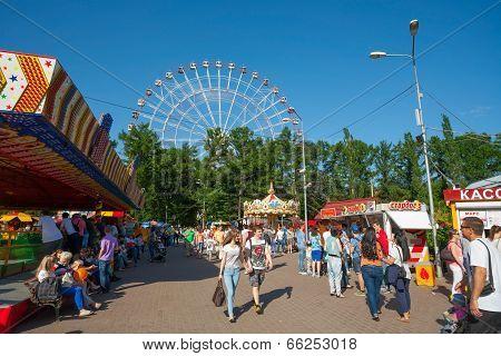 People Walking In Amusement Park