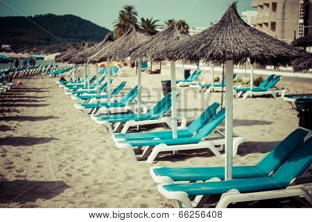 Deck Chairs Over The Sand In A Idyllic Beach In Ibiza, Balearic Islands, Spain