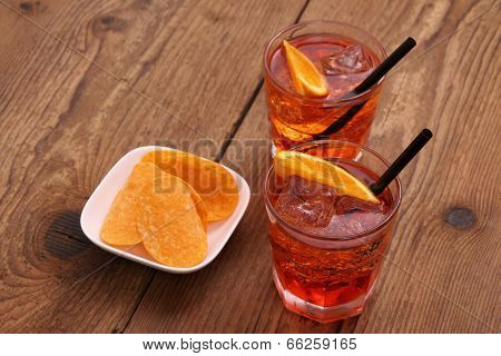 Spritz Aperitif - Two Orange Cocktail, Ice Cubes, Potato Chips
