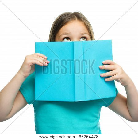 Cute Girl Is Reading Book