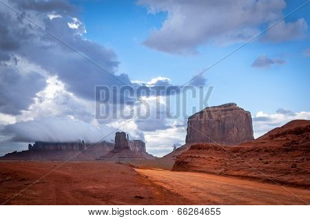 Monument Valley Road With Big Thunder Cloud In Background