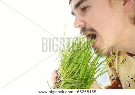 Young Man Biting Green Grass