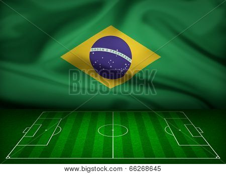 Soccer field with flag of Brazil background