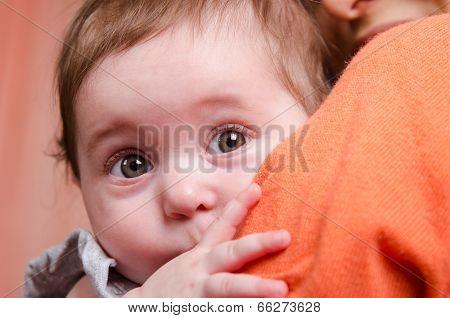 Scared Kid Hiding Behind Mom's Shoulder