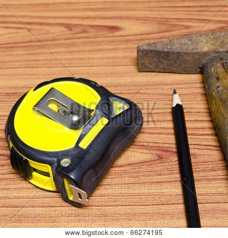 Hammer Measuring Tape And Pencil