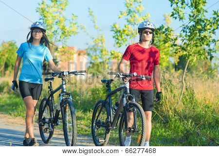 Caucasian Cycling Athlets Exercising Relaxing During Their Exercise In Nature Environment Outdoor