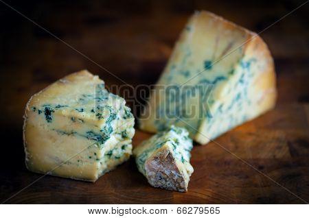 Stilton mature blue mouldy cheese - Dark background