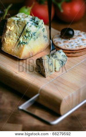 Cheese board Stilton mature blue mouldy and grapes and crackers