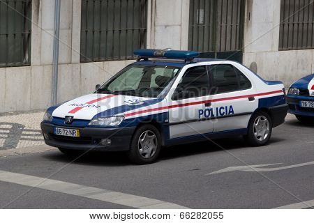 LISBON, PORTUGAL - MAY 26, 2014: Public Security Police (PSP) car on the street in Lisbon. PSP is the national Portuguese police force. The PSP is generally known for policing urban areas.