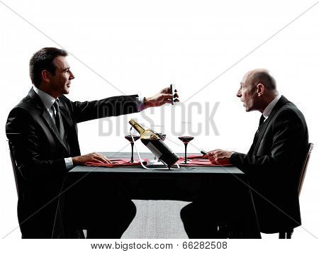 two businessmen dinning using smartphones in silhouettes on white background