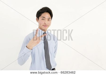 Asian young businessman with two finger peace sign