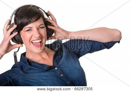 Happy Young Lady Listening To Music With Headphones